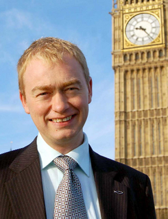 Tim Farron portrait in front of Westminster