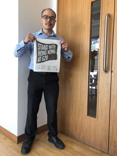Larry Ngan holding Guardian Newspaper HK campaign